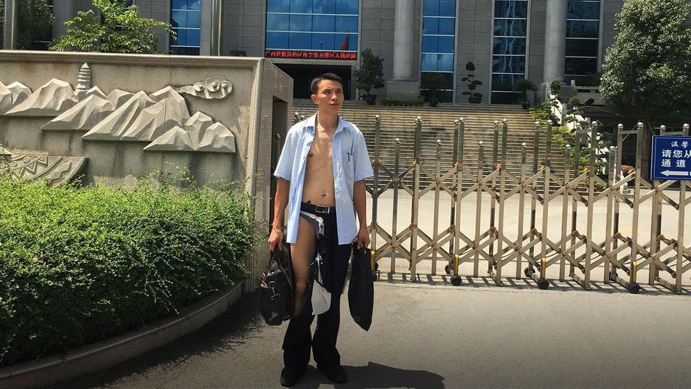 Chinese lawyer Wu Liangshu told reporters his clothes had been ripped off by police officers in court (Credit: Wu Liangshu)