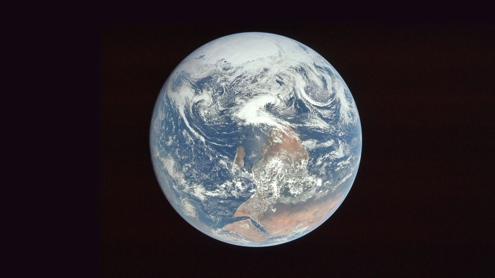 This image of Earth was photographed this way round, but flipped before publication (Credit: Nasa)