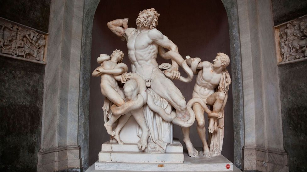 Two sharp-fanged sea serpents writhe around the agonised Trojan priest Laocoon and his innocent sons (Credit: Alamy)