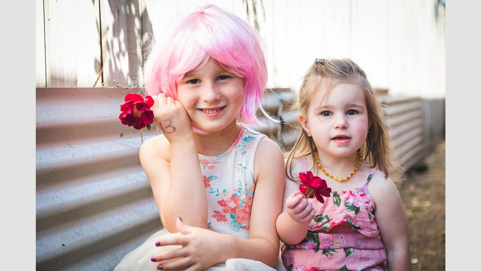 Five-year-old Briella, pictured here with her sister Shayla, took part in a series of portraits of transgender children by photographer Emma Leslie (Credit: Emma Leslie)