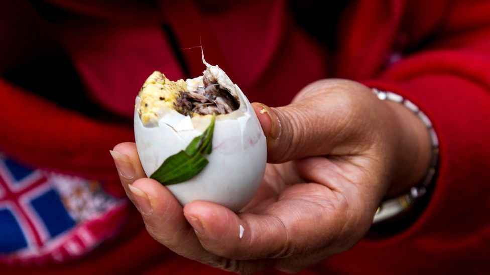 Balut is a boiled duck embryo seasoned with salt or vinegar, chilies and onions (Credit: suraark/Getty)