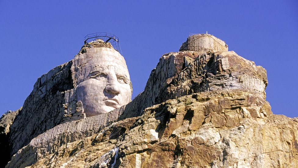 The Crazy Horse Memorial 17 miles from Mount Rushmore depicts the face of the Oglala Lakota leader 87ft high, compared to the presidents' 60ft faces (Credit: Alamy)