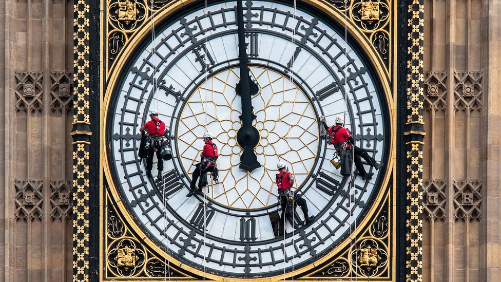 Workers clean the clock face of Elizabeth Tower; the refurbishment that starts in 2017 will be one of the biggest in the clock's history (Credit: UK Parliament)
