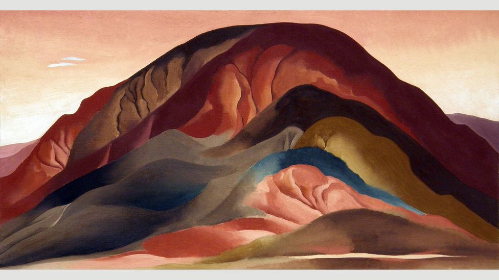 The bright light brings out colours in the landscape, including the ochre and smoked-chilli red of the rocks (Credit: 2016 Georgia O'Keeffe Museum/DACS, London)