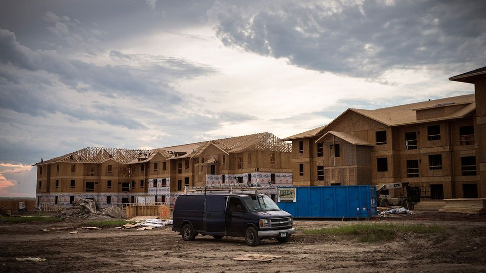 Just four years ago, news stories gushed about the new oil boom that had flooded towns like Williston with fresh wealth - now the houses are empty or occupied by squatters.