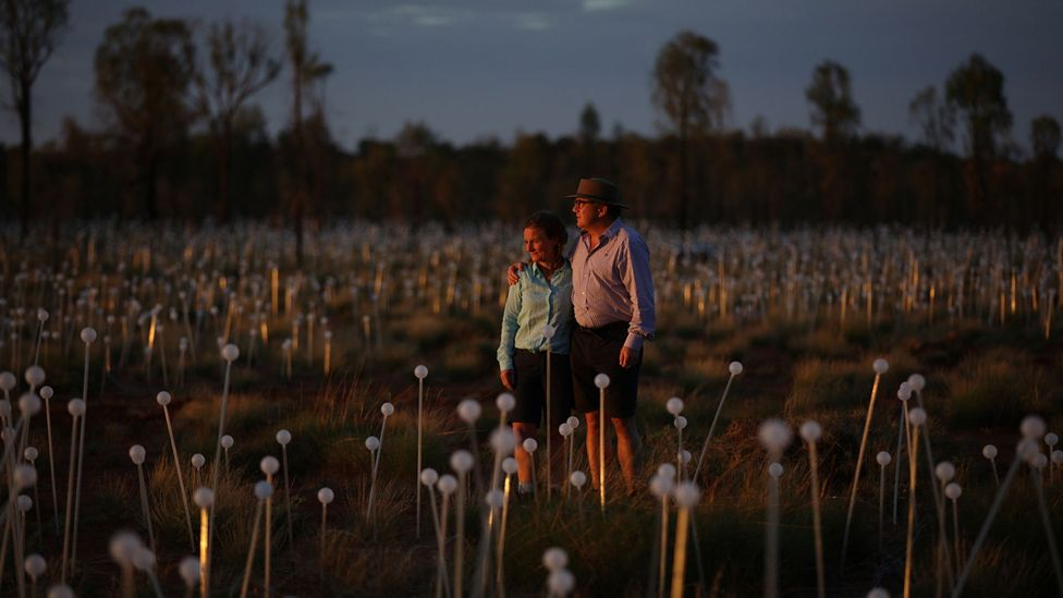 Bruce and Serena Munro stand among the Field of Light's flower-like bulbs (Credit: Mark Pickthall)
