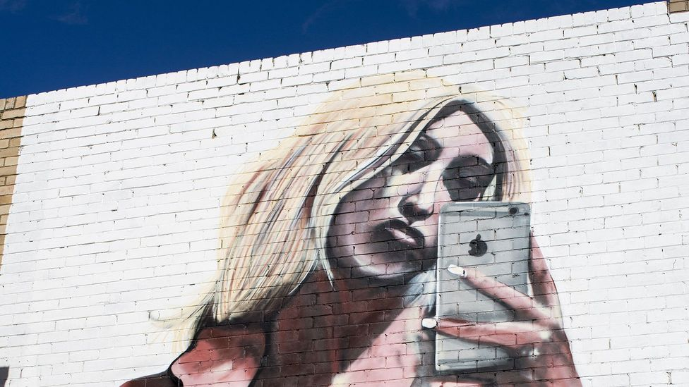 "A mural of Kim Kardashian's infamous naked selfie, reportedly by street artist ""lushsux"" painted on a wall in Gwynne Street in Cremorne, New South Wales (Credit: Rex Features)"