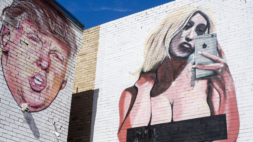 A mural of Kim Kardashian's infamous naked selfie next to a mural of Donald Trump, reportedly the work of the street artist 'lushsux' (Credit: Rex Features)
