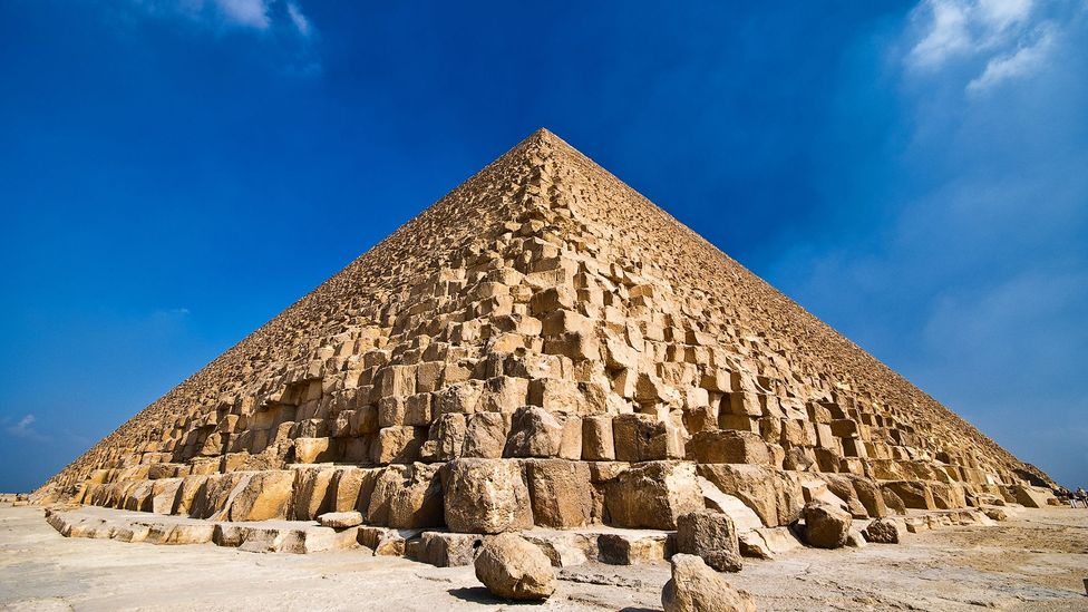Originally the Great Pyramids at Giza were white – it's thought the valuable outer casing stones were stolen (Credit: Getty Images)