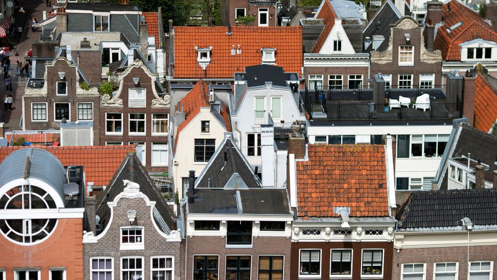 The rooftops of traditional Dutch residential properties on a street in Amsterdam, The Netherlands (Credit: Jasper Juinen/Bloomberg/Getty Images)