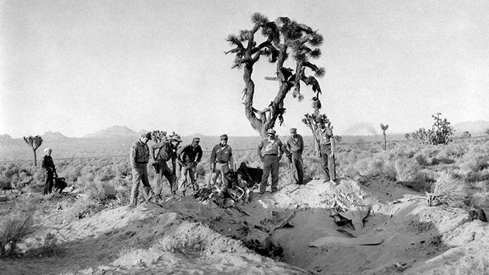 Military and local law enforcement personnel examine the crash site of the drone near Palmdale (Credit: Los Angeles Public Library collection)