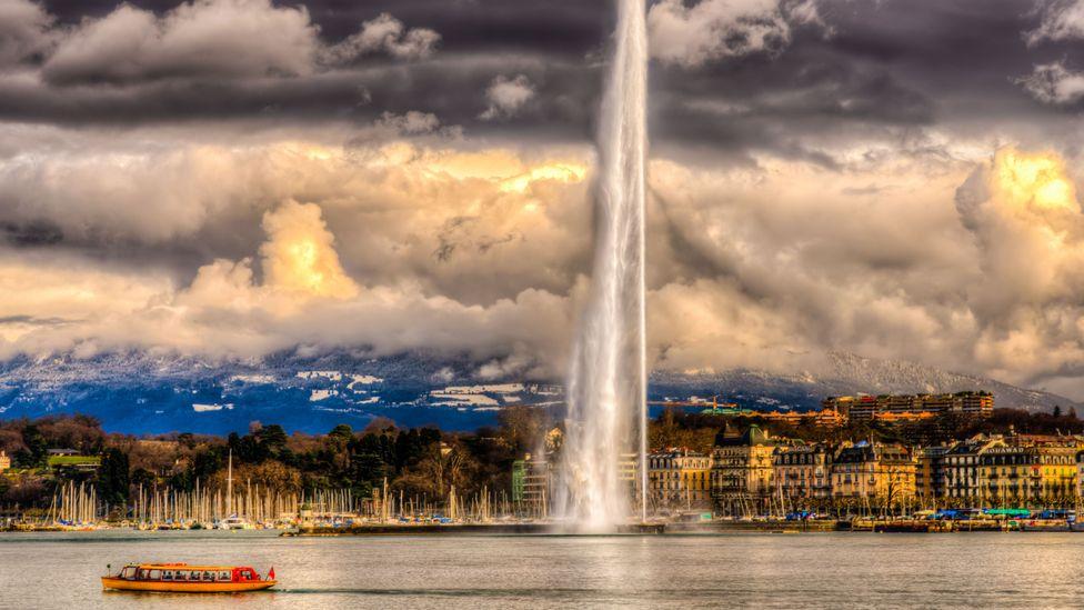 Jet D'eau across Lake Geneva on a dramatic cloudy day (Credit: Oguzhan Altun/altunphotography.com/Getty Images)