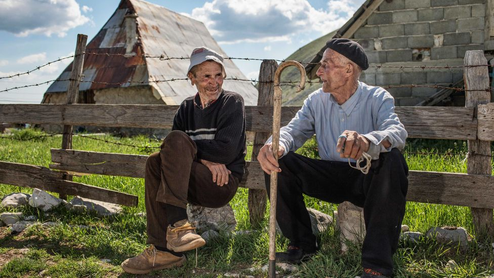 Two old men chatting in Lukomir, the most remote village of Bosnia and Herzegovina (Credit: Roberto Nistri / Alamy)