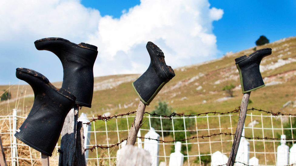 Boots drying on poles in Lukomir (Credit: Roberto Cornacchia / Alamy)