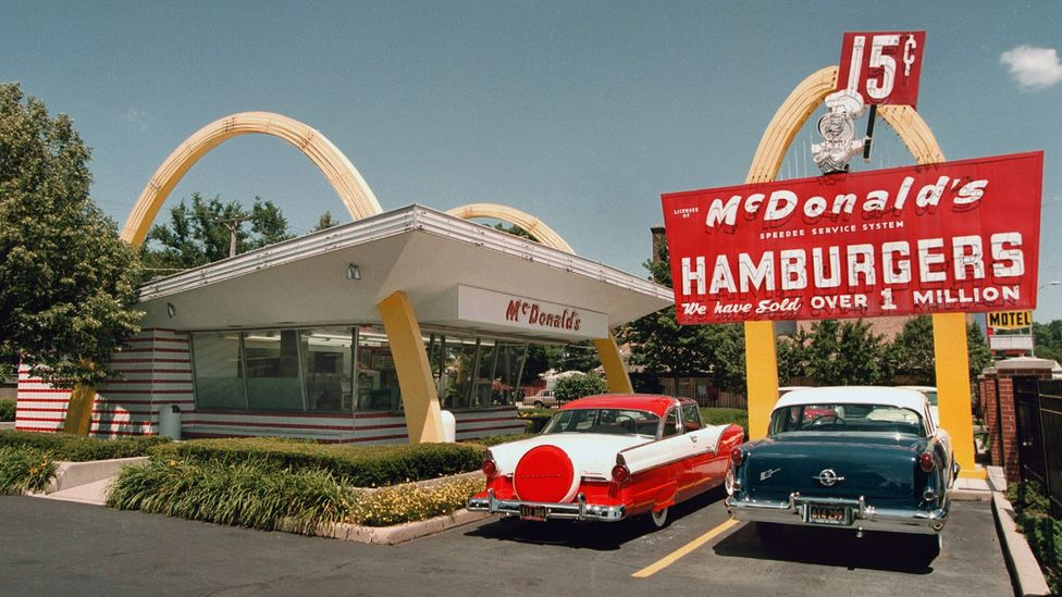 Los Angeles architect Stanley Clark Meston designed a sleek, futuristic McDonald's restaurant flanked by twin golden arches in 1953 (Credit: Getty Images)