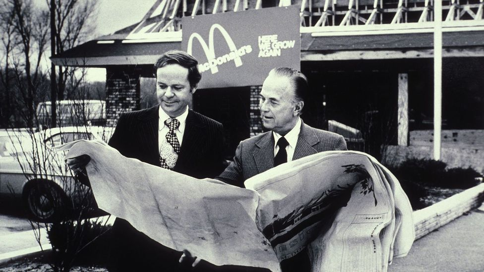McDonald's CEO Ray Kroc (right) replaced Meston's original ultra-modern building with a more traditional, mansard-style roof (Credit: Alamy)