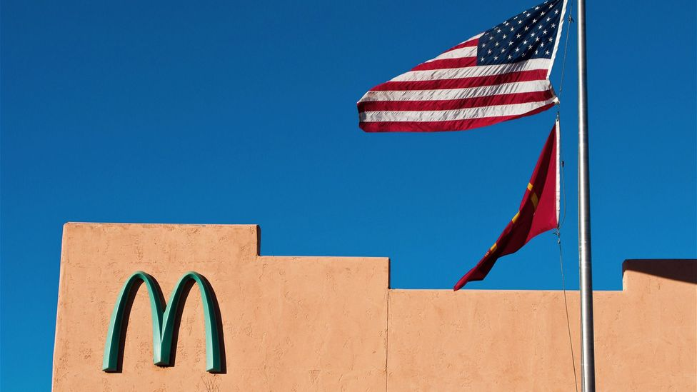 Though McDonald's is very protective of its logo, the company has been willing to alter its colour to conform to local building codes around the world (Credit: Alamy)
