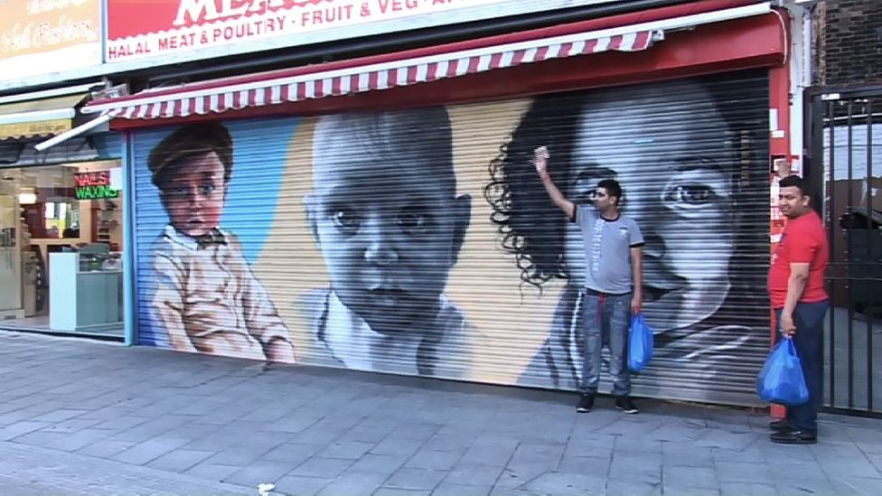 When babies' faces were painted on these shutters in south-west London, crime decreased (Credit: YouTube)