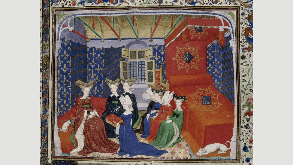 Christine de Pizan, shown here in a 15th-century miniature presenting her book, imagined utopia as a female-only city (Credit: Master of the Cité des Dames/British Library)