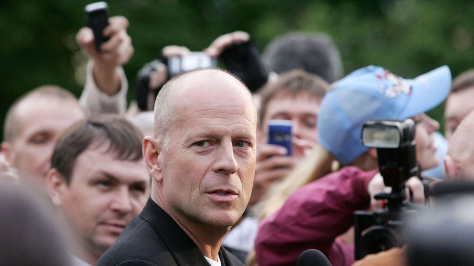 Bruce Willis has made a career out of his bald head, which contributes to his dominant, tough guy look (Credit: Alamy)