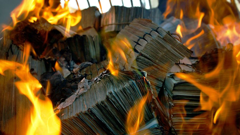 Bundles of old bills are destroyed in a furnace in Kabul, Afghanistan (Credit: Paula Bronstein/Getty Images)