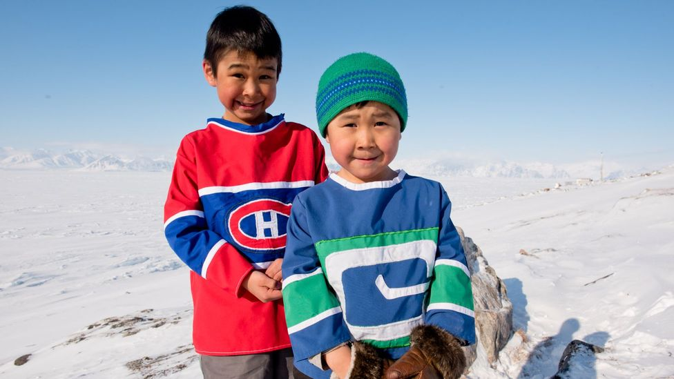 Residents repurpose flags and banners to create hockey jerseys and parkas (Credit: Eric Guth)