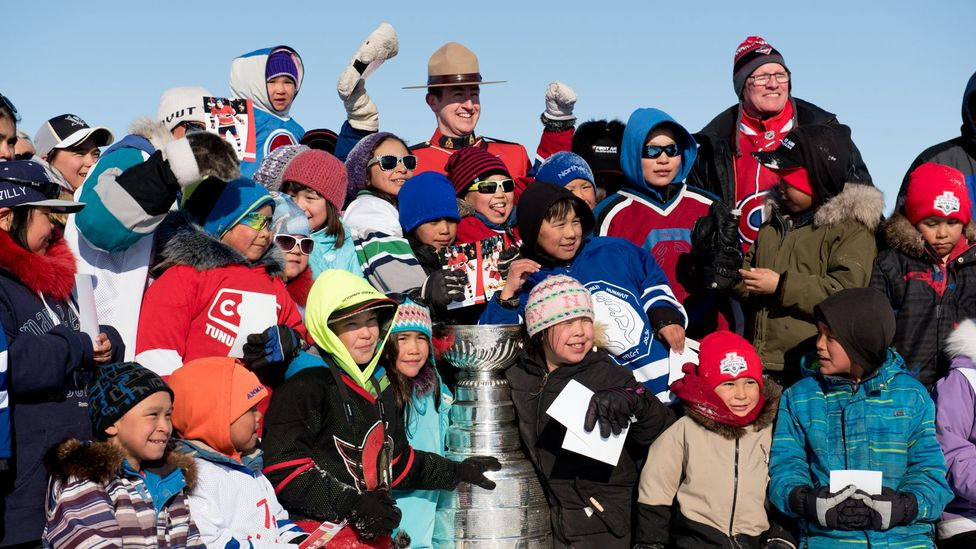 Children and adults took pictures with the cup to memorialize the event (Credit: Eric Guth)