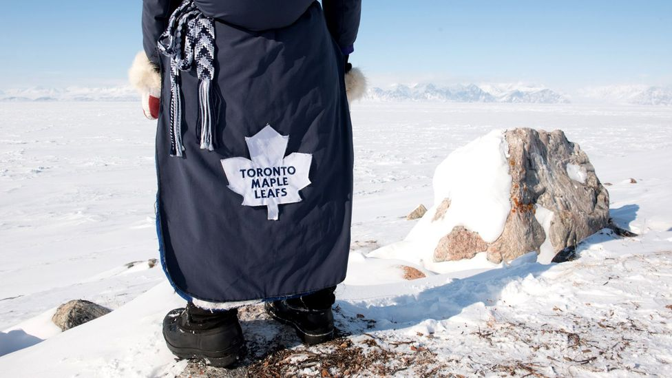 The town's residents proudly adorn themselves in attire supporting their favourite team (Credit: Eric Guth)
