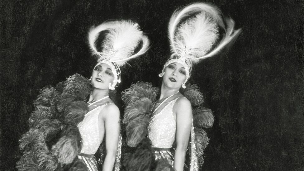The Dolly sisters were twins who came to epitomize the extravagance of the 1920s – they were paid $1,200 a night to appear at the Moulin Rouge (Credit: James Abbe Archive)