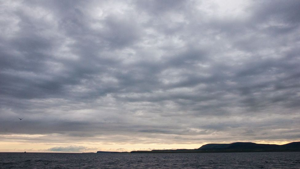 The boat journey to St Kilda from the Isle of Skye takes 3.5 hours – often under moody skies like these. (Credit: Amanda Ruggeri)