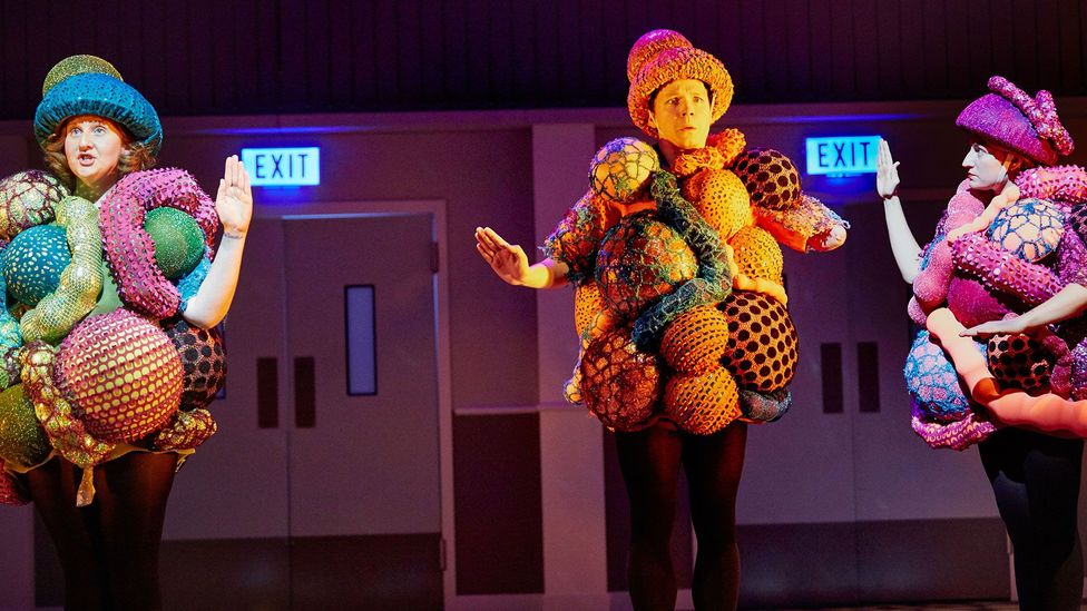 Christina Cunningham's costumes for A Pacifist's Guide to the War on Cancer feature glittery outfits based on the forms of malignant cells (Credit: Mark Douet)