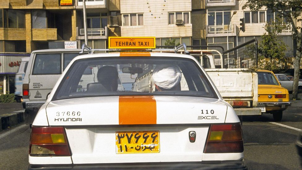Even taxi drivers may try to politely decline payment until further insistence (Credit: Kaveh Kazemi/Getty)