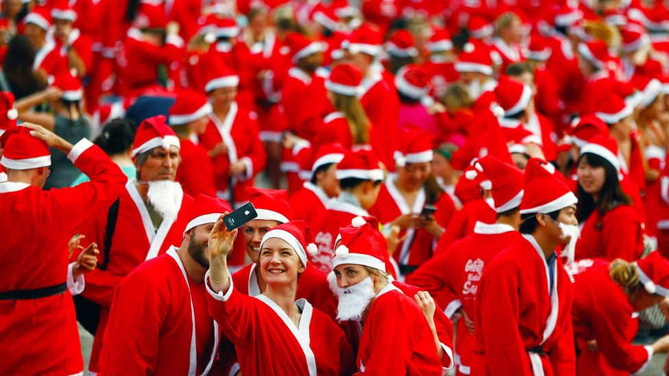 Participants of the Great Kids Can Santa Run in New Zealand dress up as Santa Claus to benefit children affected by poverty (Credit: Phil Walter/Getty)