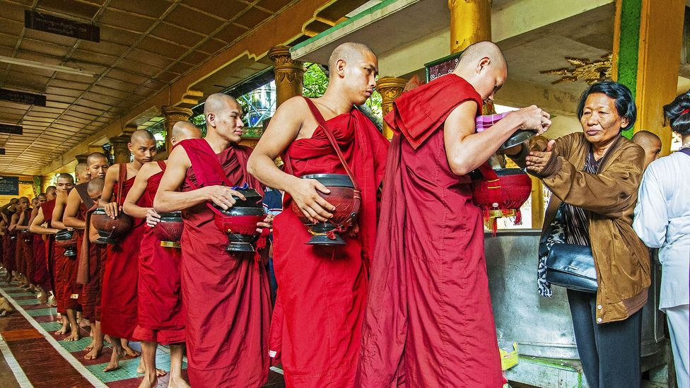 In Burma, donating food to monks is a common practice under the Buddhist tradition (Credit: Stefano Politi Markovina)