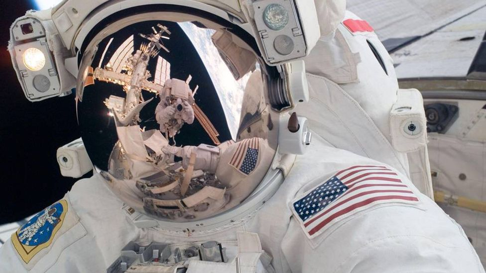 Ron Garan (seen reflected in the visor) made two trips to the International Space Station (Credit: Nasa)