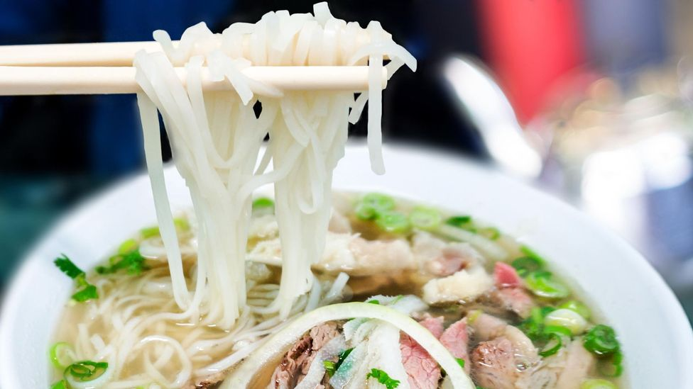 Beef pho (pho bo) is eaten throughout the day (Credit: Ronnie Chua/Alamy)