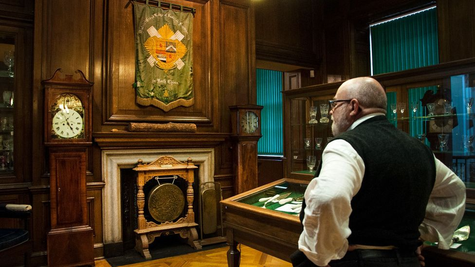 The curator of the Grand Lodge of Scotland, Robert Cooper, looks over the lodge's museum (Credit: Amanda Ruggeri)