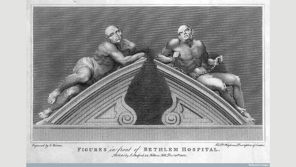 Statues of 'melancholy' and 'raving' – thought to be the two sides of mental illness – crowned the entrance gates to the hospital (Credit: Wellcome Library, London)