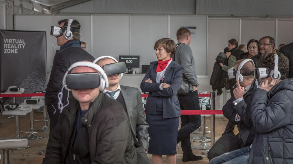 Invited guests enjoy a virtual reality experience in the hospitality tent at the Chernobyl nuclear power plant (Credit: Anton Skyba)
