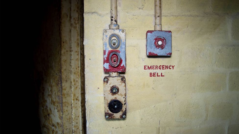 An emergency bell inside Drakelow's 'safe room', which has no windows and a heavy steel door (Credit: William Park)