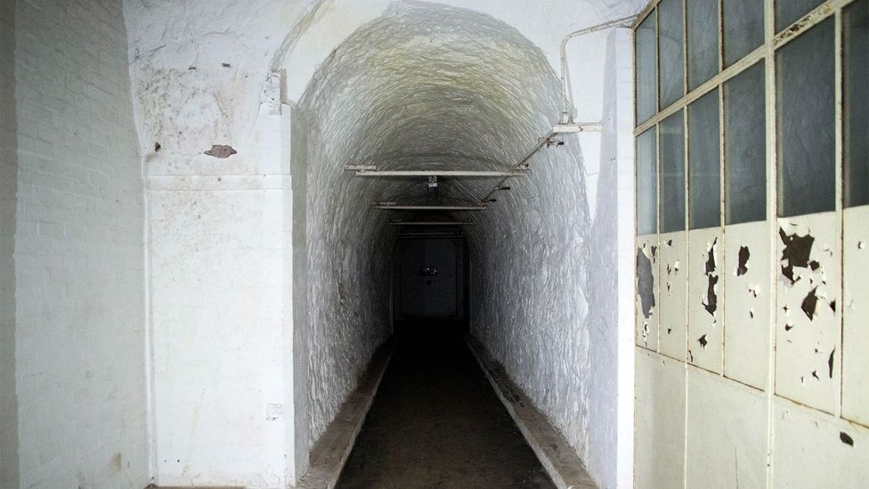 A tunnel leading from the RSG offices to a bricked-up wall; behind here, the rest of the factory lies empty (Credit: William Park)