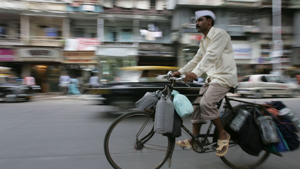 On the crowded streets of Mumbai, trains and bicycles are quicker than cars and motorbikes (Credit: Getty Images)