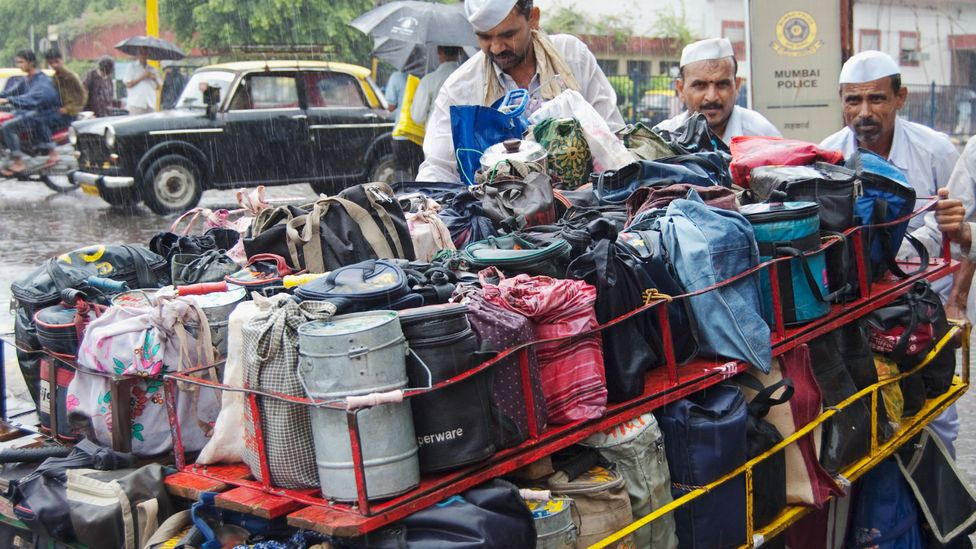 Lunchboxes coming from all over the city are loaded onto bicycles and handcarts for the final leg of their journey (Credit: Getty Images)