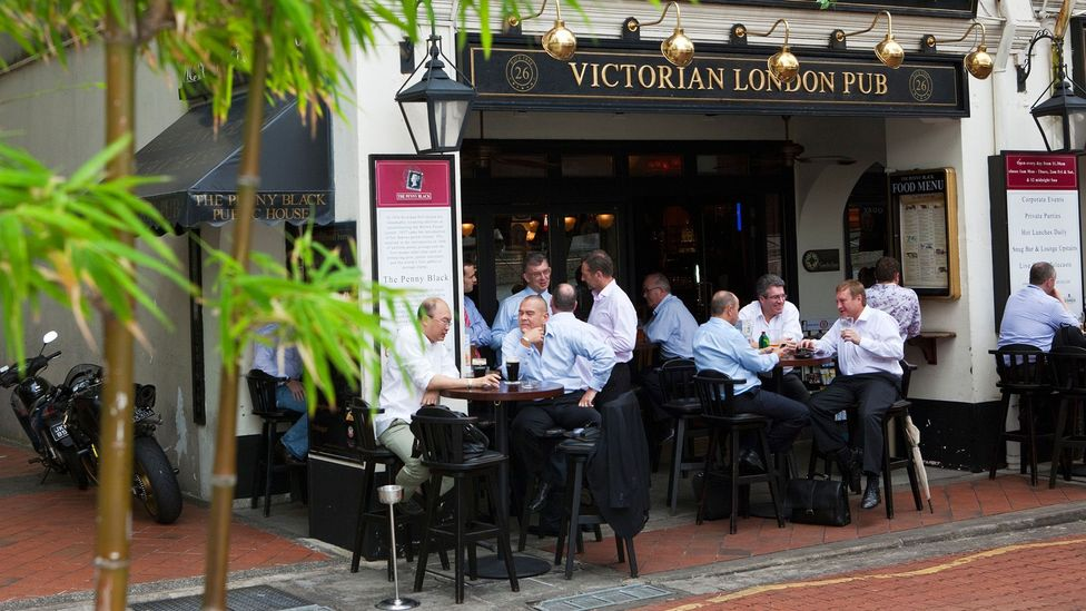City workers drinking at a British style pub in Boat Quay, Singapore (Credit: Alamy)
