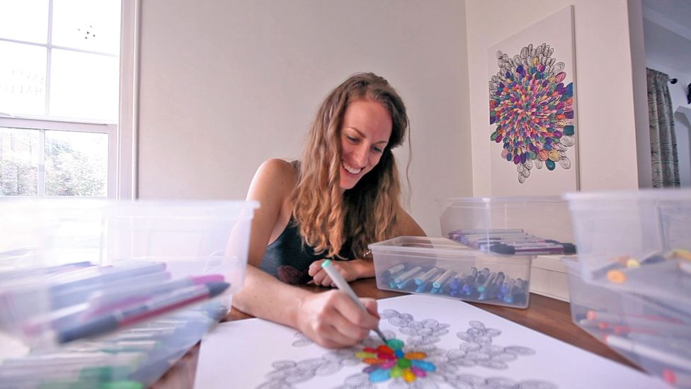 Amy Jones started selling goal-tracking art after a visual aid helped her pay off $26,000 in debt. Each swirl on her canvas represented $100 paid off (Credit: Map Your Progress)