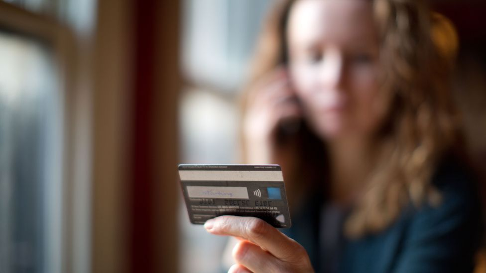 If someone is unusually hesitant when entering their banking details online it could be a sign that they are under duress (Credit: Getty Images)
