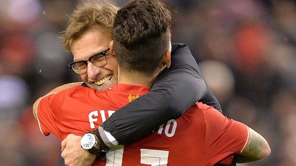 While skills are key, warmth is what brings out the best in teams. Here, Liverpool manager Jurgen Klopp embraces midfielder Roberto Firmino (Credit: Paul Ellis/AFP/Getty Images)