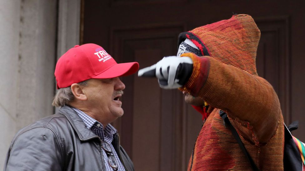 A Donald Trump supporter and a protestor argue during the Women's March On Washington on 21 January 2017 (Credit: Tasos Katopodis/Getty Images)