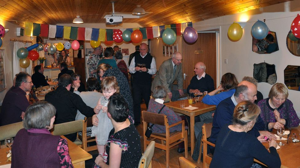 Residents gather for a recent wedding anniversary party; everyone on the island was invited (Credit: Douglas Hourston)