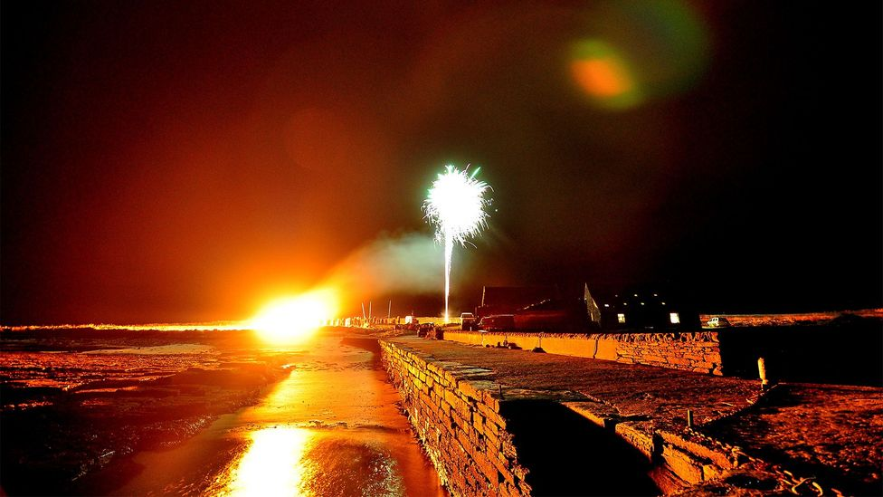 Community events, like this Bonfire Night at Papay's local pier in November 2016, are a big part of life on the island (Credit: Douglas Hourston)